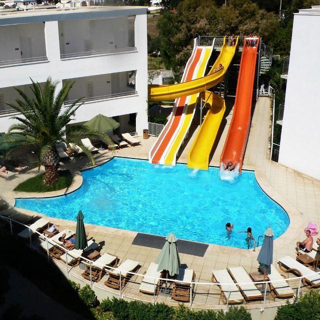 Детский бассейн с водными горками в Armonia Holiday Village & Spa 5
